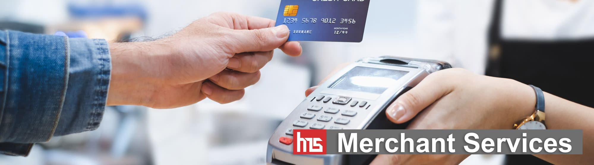 Merchant Services - merchant using payment processing on point of sale terminal