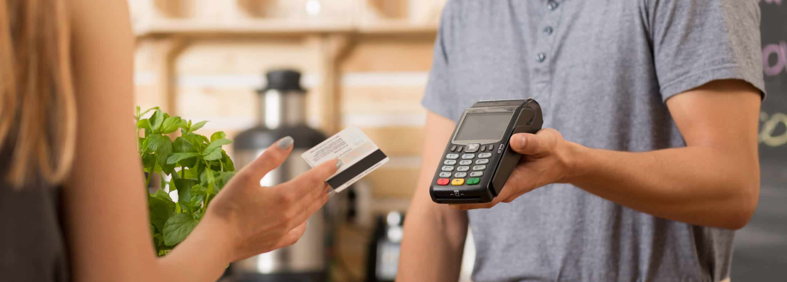Small business customer paying with debit card