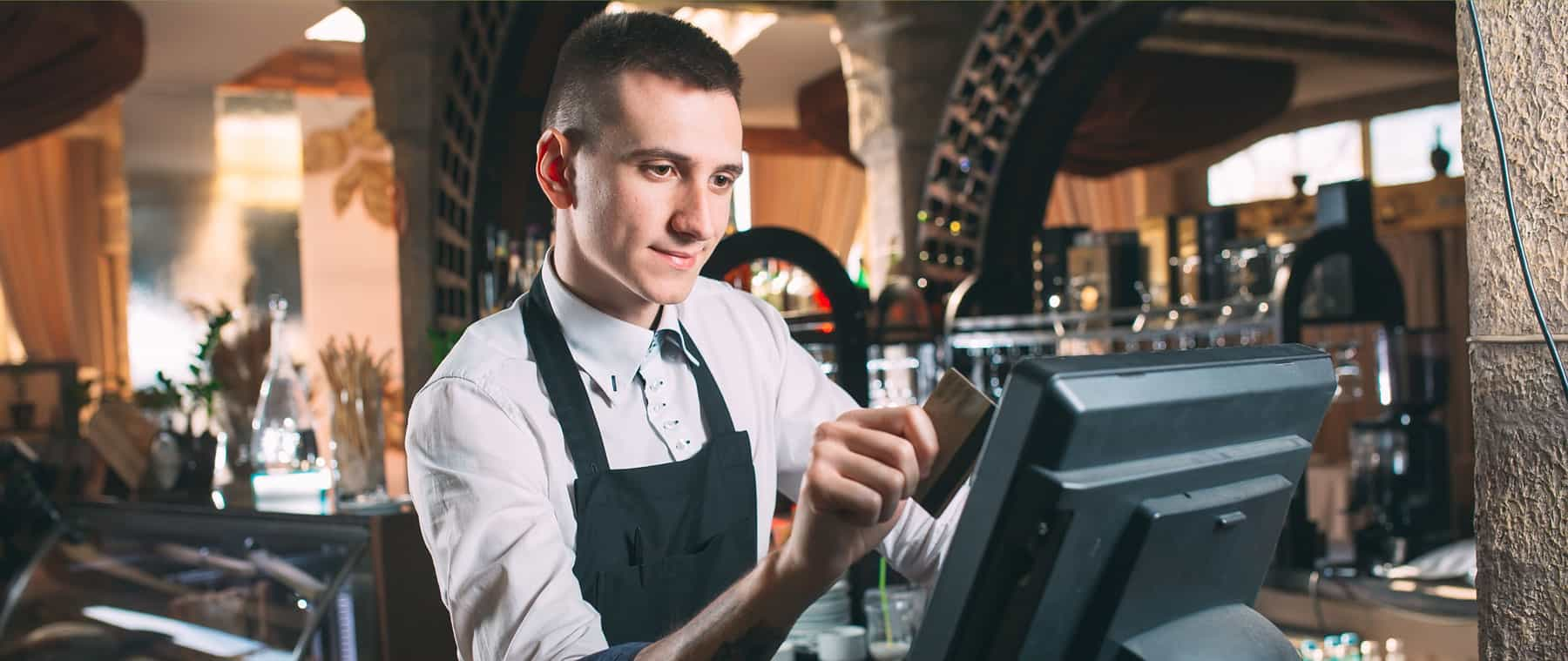 bartender enters order on point of sale with credit card