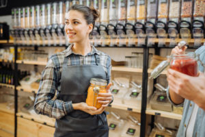 Small business Grocery store helping customer