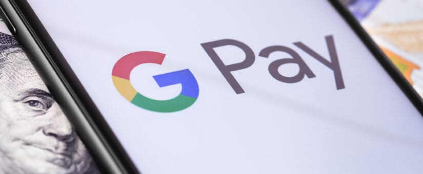 money-dollars-and-smartphone-with-google-pay-logo-on-the-screen-142599037-825x340