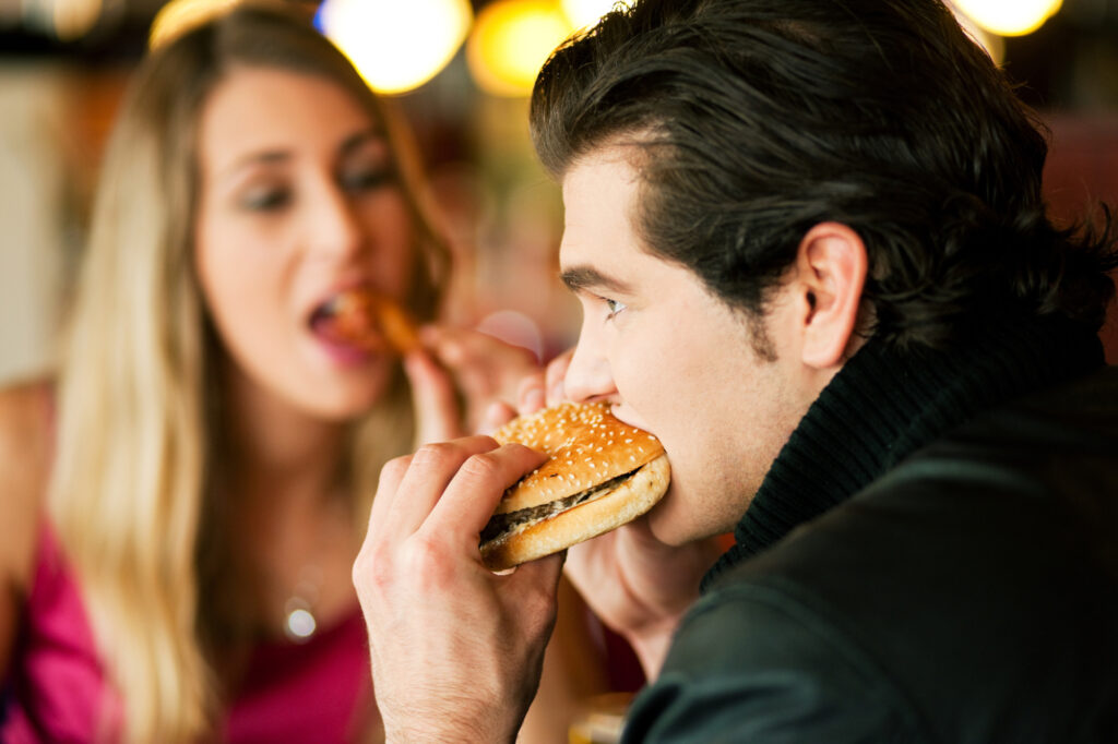 Couple In Restaurant Eating Fast Food 14084025