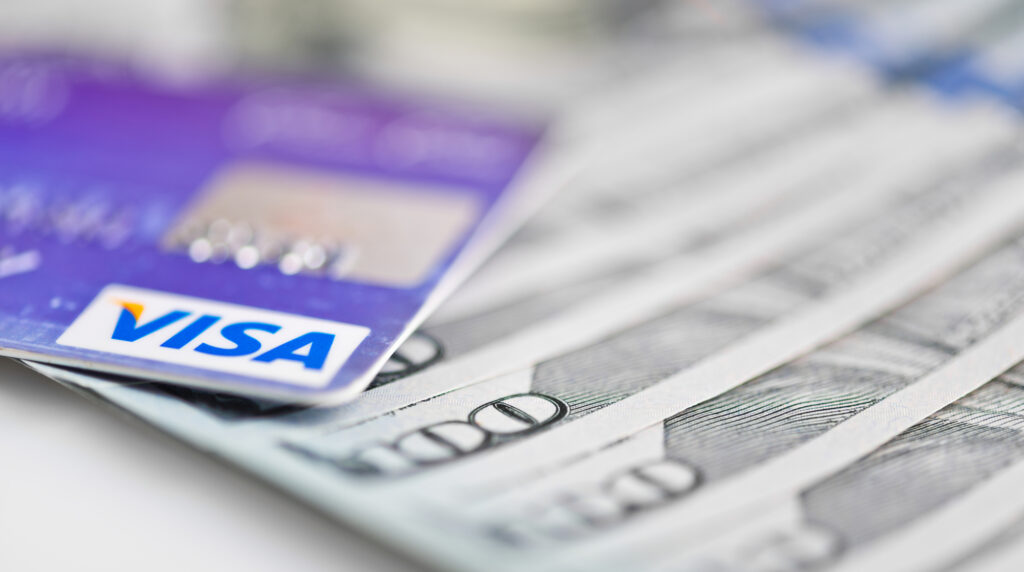 Visa Debit Cards Over Dollar Bills 40220986