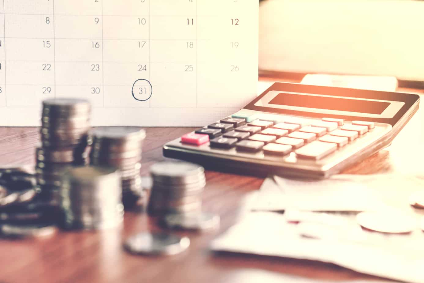 Debt Collection And Tax Season Concept With Deadline Calendar Remind Note Coins Banks Calculator On Table 107164409