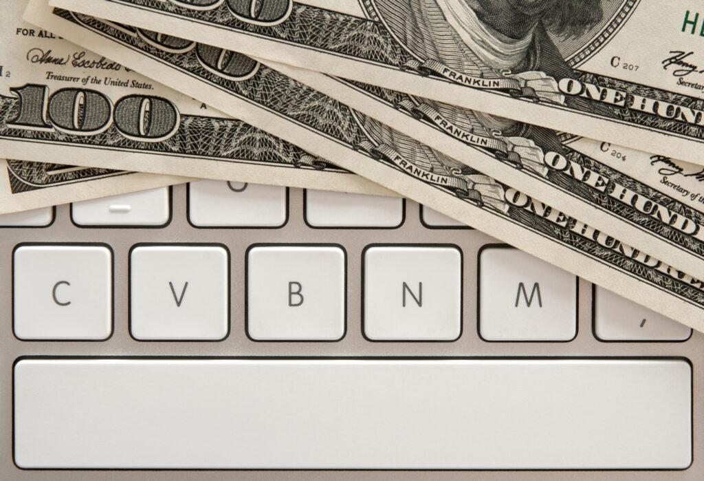 Money Bills On Computer Keyboard With Spacebar 18398807
