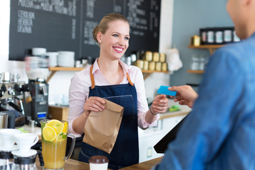 Waitress Serving Customer At The Coffee Shop 60531553