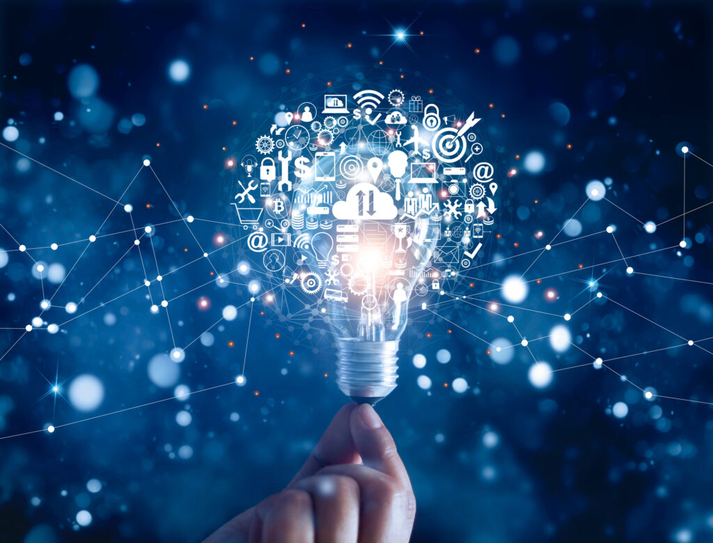 hand holding light bulb and business digital marketing innovation technology icons on network 138534565