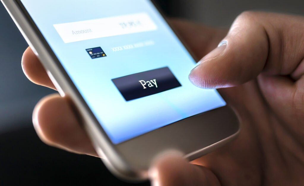 Mobile Payment With Wallet App And Wireless Nfc Technology Man Paying And Shopping With Smartphone Application And Credit Card 151771252