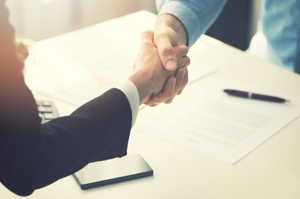 business people handshake after partnership contract signing 94512900