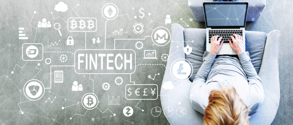 cryptocurrency fintech theme with man using a laptop 118540980