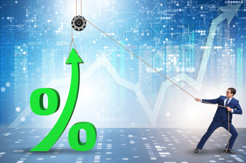 the businessman increasing interest rate in market 140746938