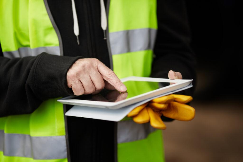 construction worker using digital tablet 26473215