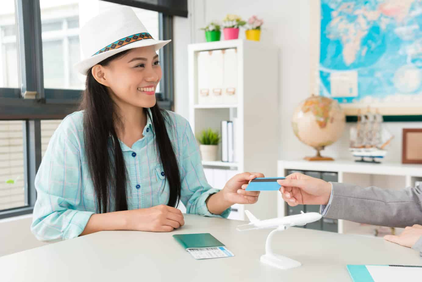 smiling pretty woman traveler giving credit card 109718176