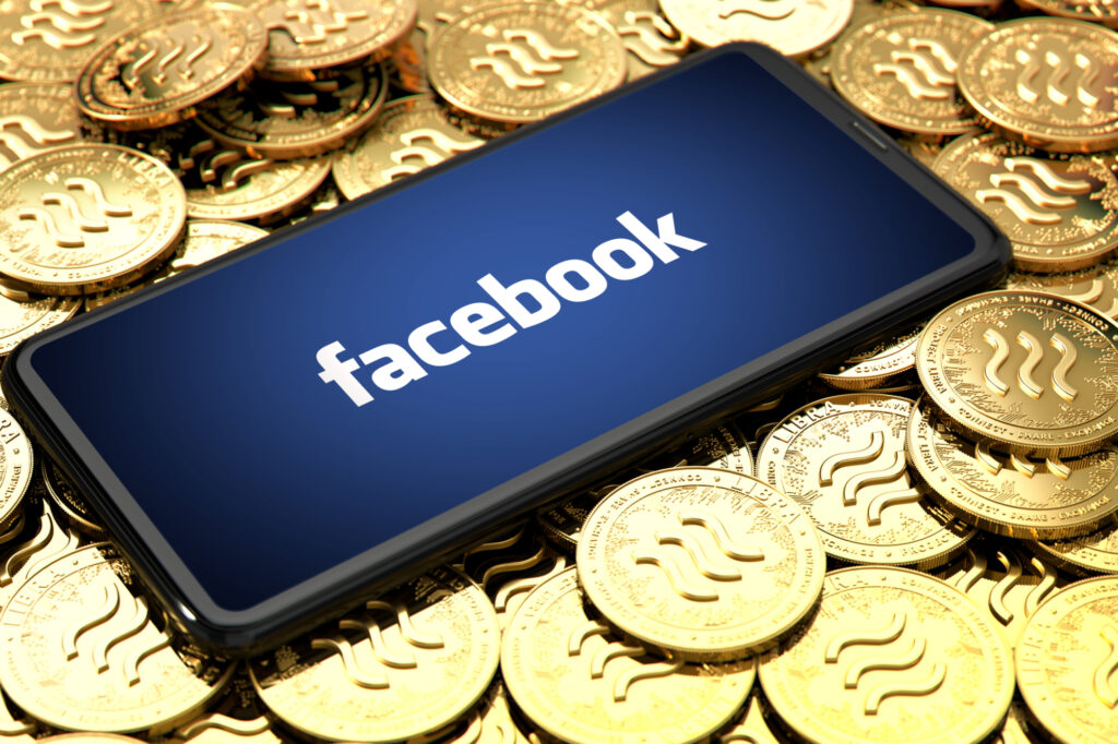 wroclaw poland june 20th 2019 facebook announces libra cryptocurrency smartphone with facebook logo on the screen is laying 151024926