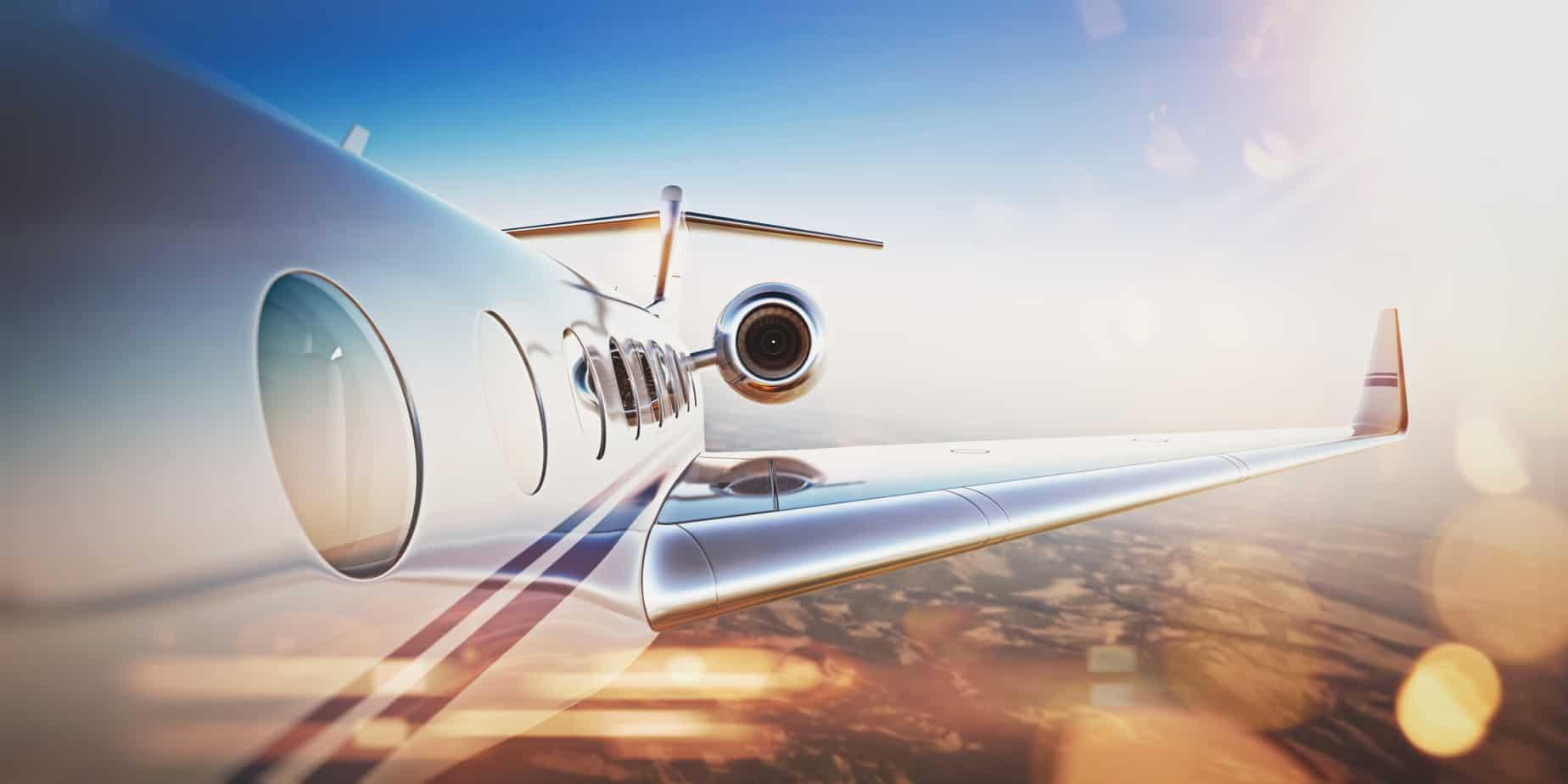 business travel concept generic design of white luxury private jet flying in blue sky at sunset uninhabited desert 85089873