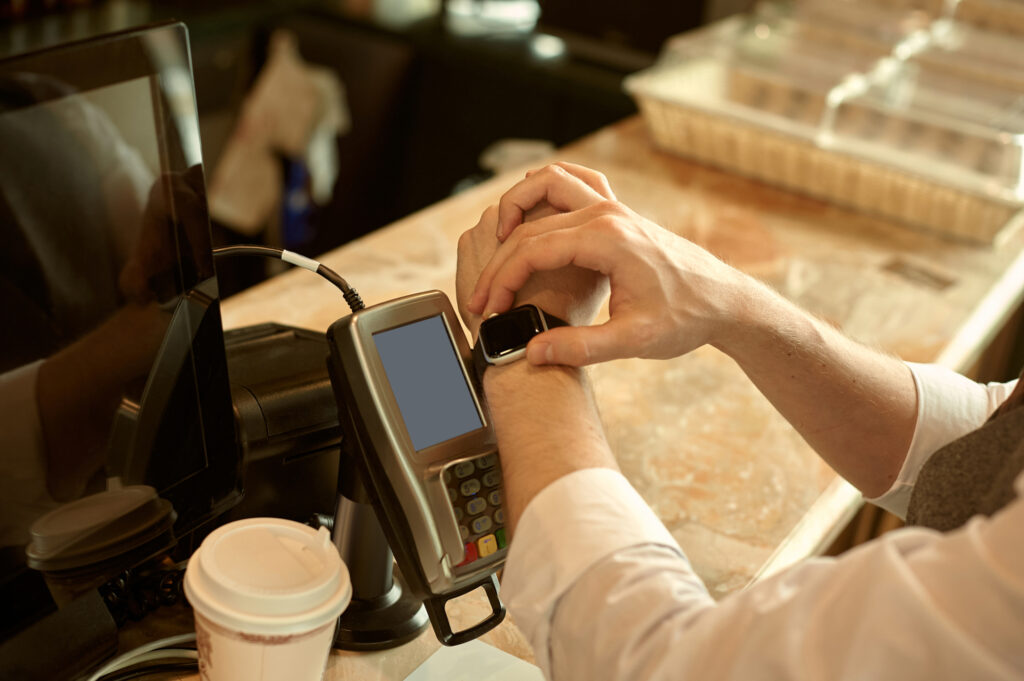man using smart watch to pay in restaurant nfc contactless convenient payment service 215885687