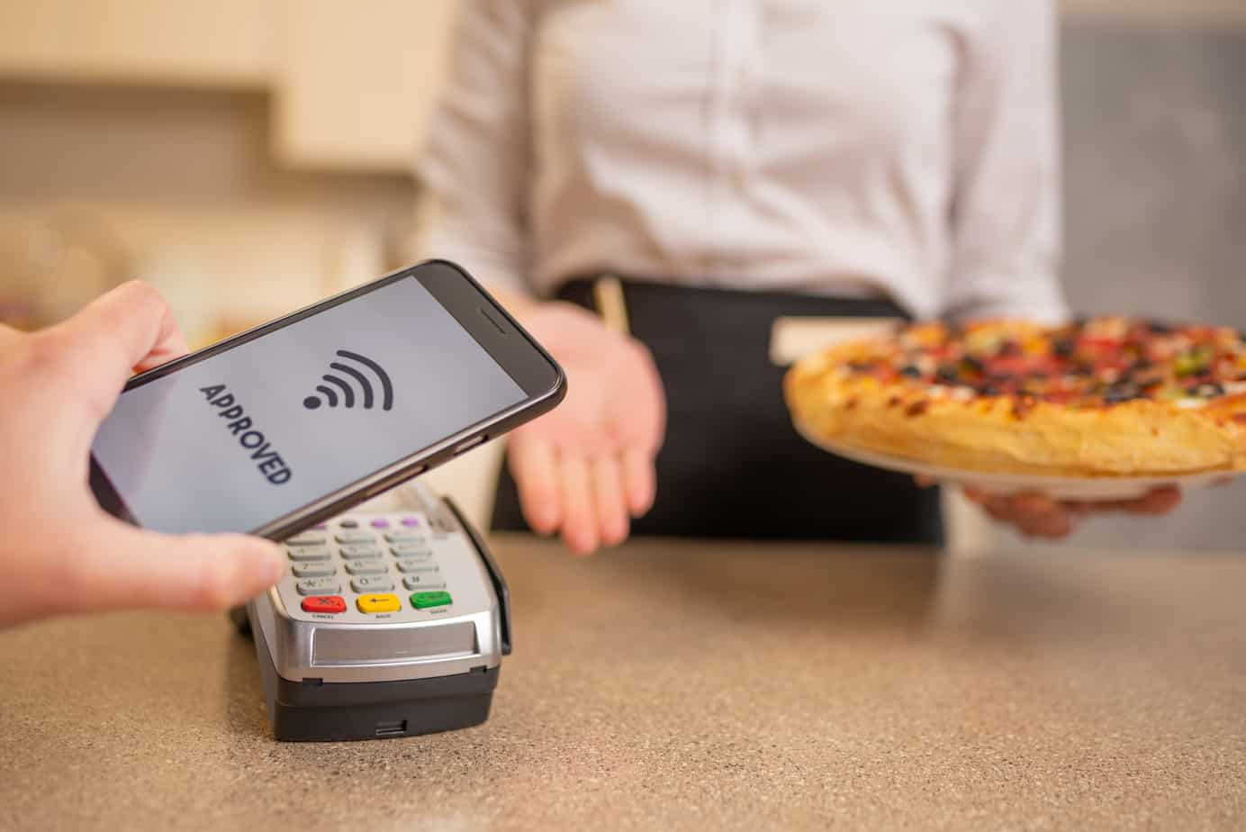 payment by contactless payment for pizza in a restaurant or cafe cashless payments banking services a new life according to the 190394627