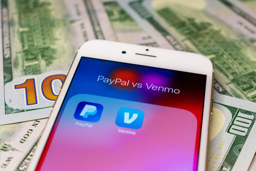 paypal vs venmo smartphone folder with blurred paypal and venmo mobile payment service applications 212752189 (2)