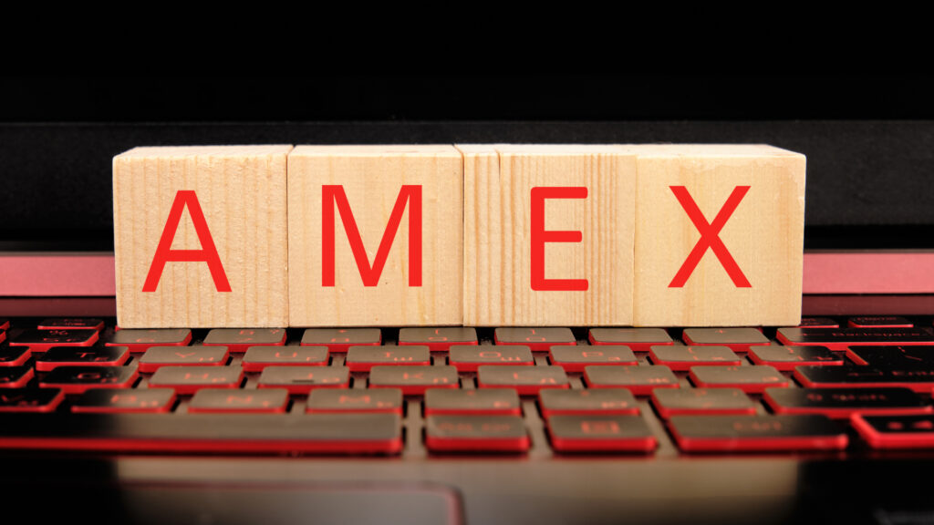 a wooden bar with a amex word written on it on the illuminated laptop keyboard 204528173