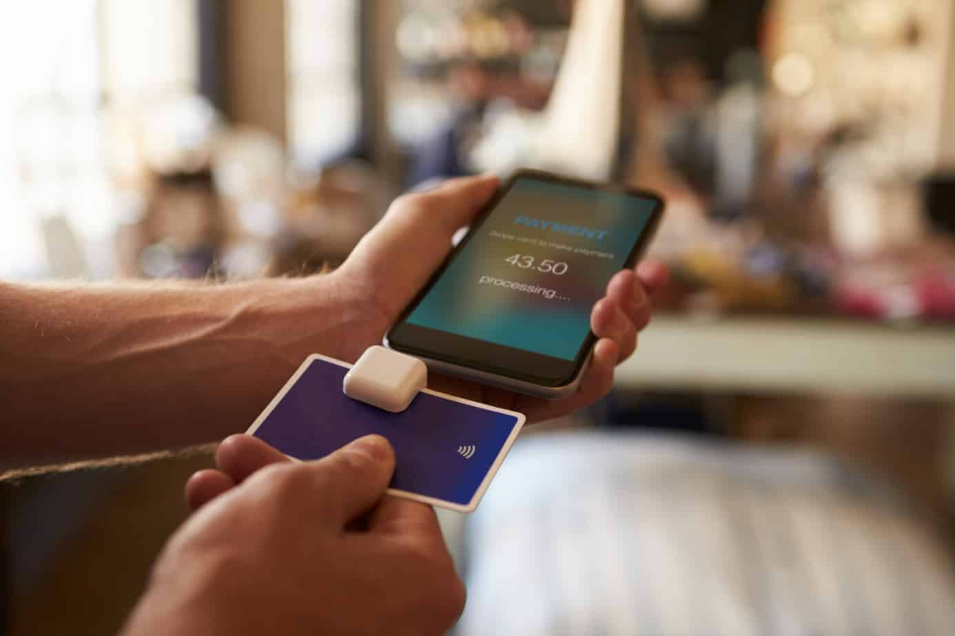 credit card payment app attached to mobile phone 67534402