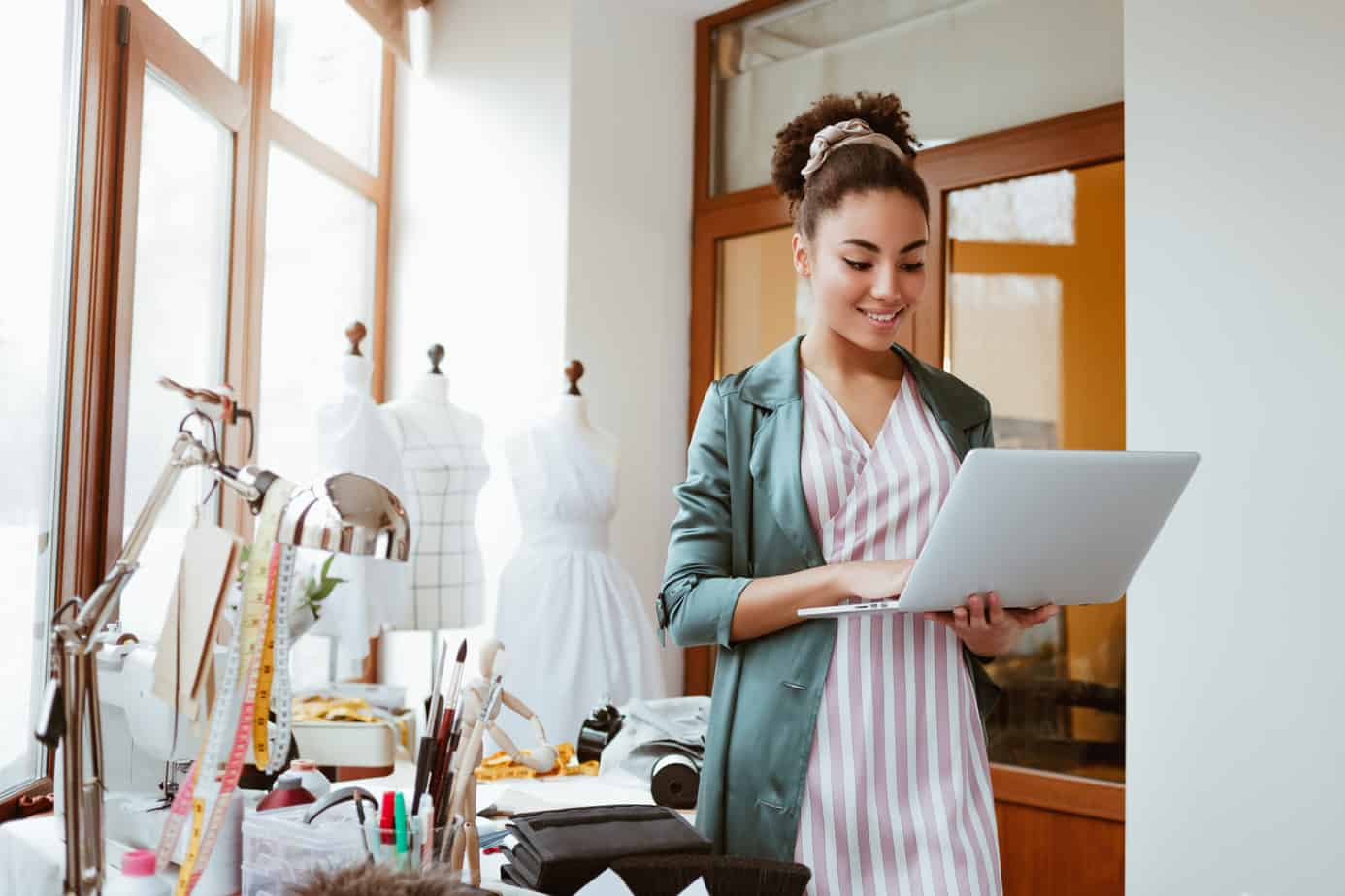 online orders by email young woman tailor with laptop is answering emails 138513948