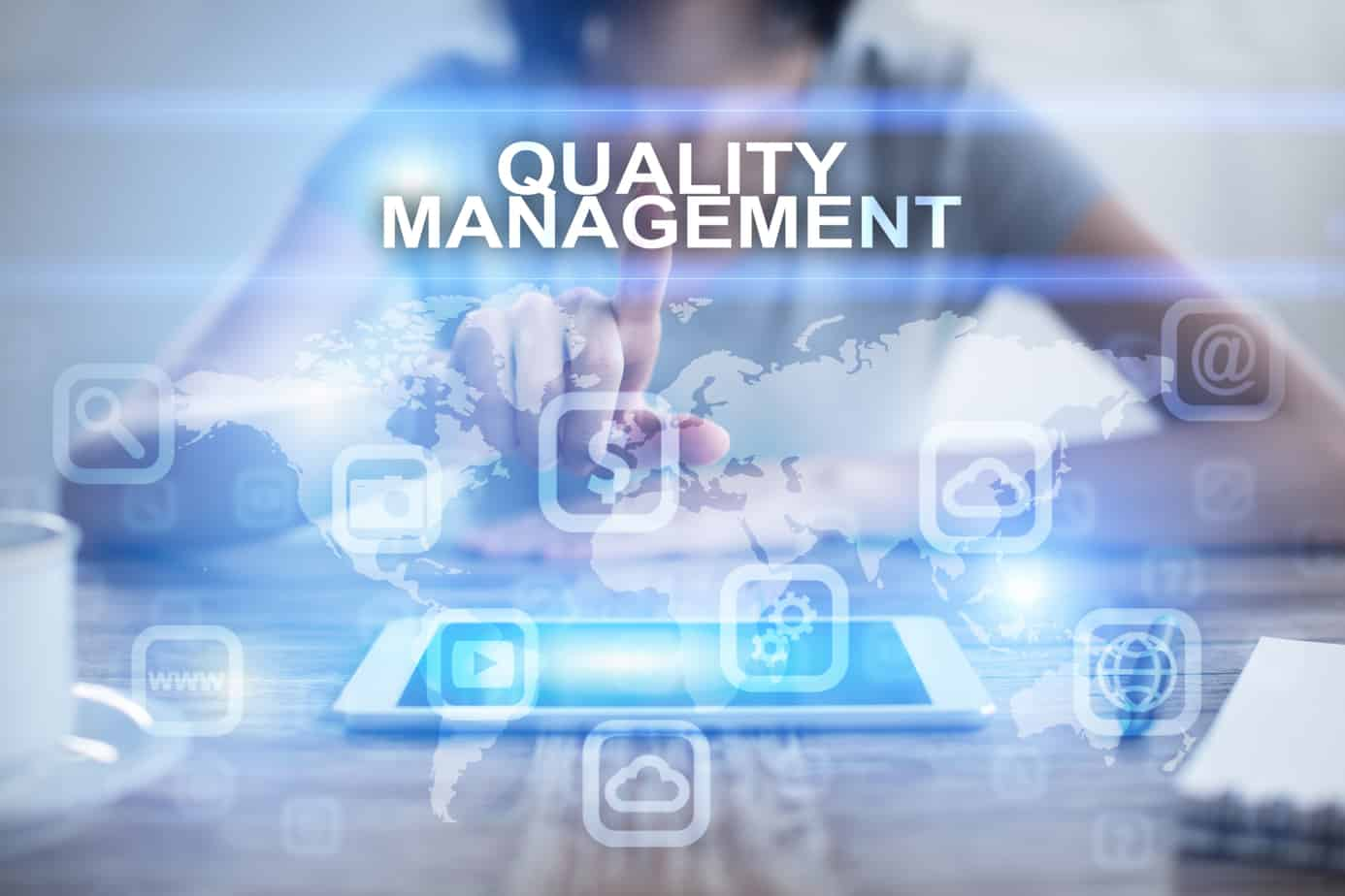 woman pressing on virtual screen and selecting quality management 90298183
