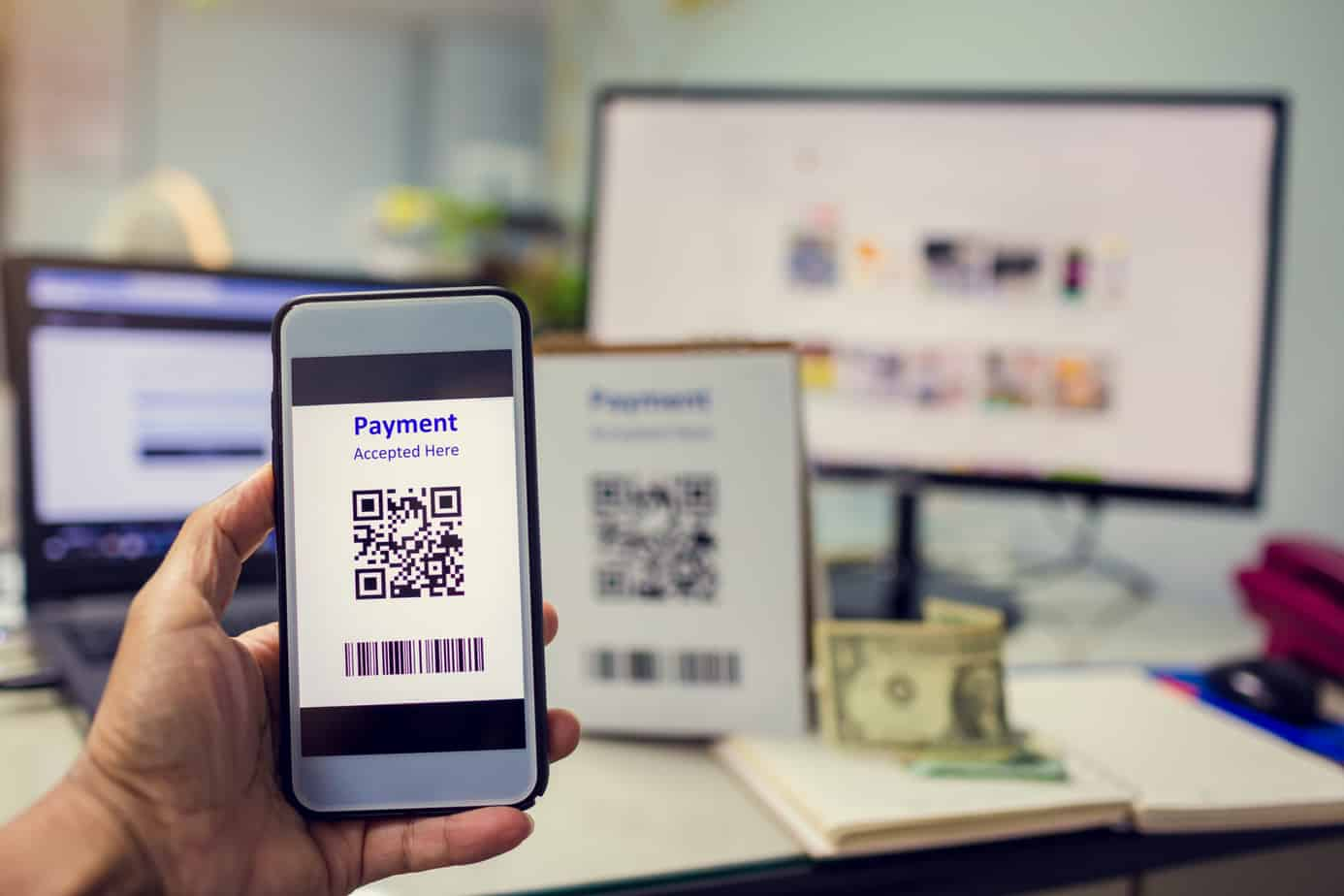 selective focus to customer hand holding smart phone to scan qr code payment 188176594