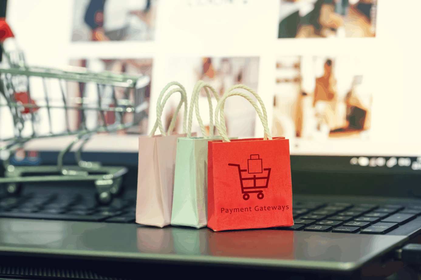 shopping online e commerce concept paper shopping bags on notebook keyboard depicts purchase of products and services on the 202873753