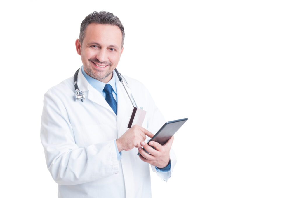 smiling doctor or medic using credit card and wireless tablet 61908444